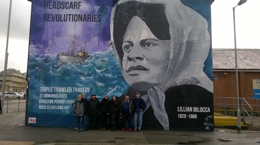 The Cuban artists in Hull in front of mural dedicated to women who fought for justice for fishing trawler workers